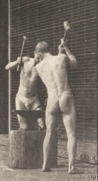Men in pelvis clothes hammering an anvil