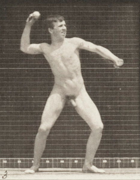 Nude man throwing baseball