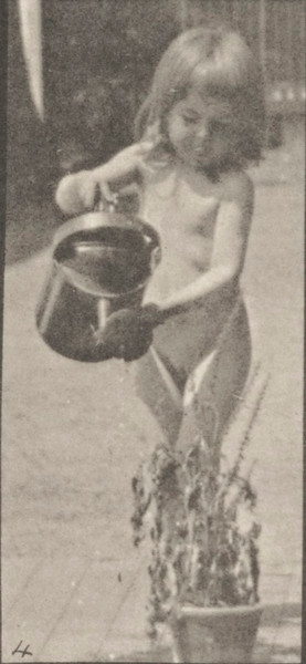 Nude child watering flowers