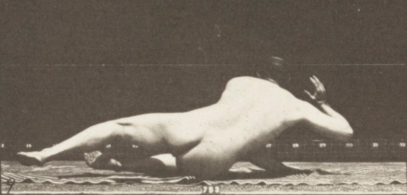 Nude man lying on the ground