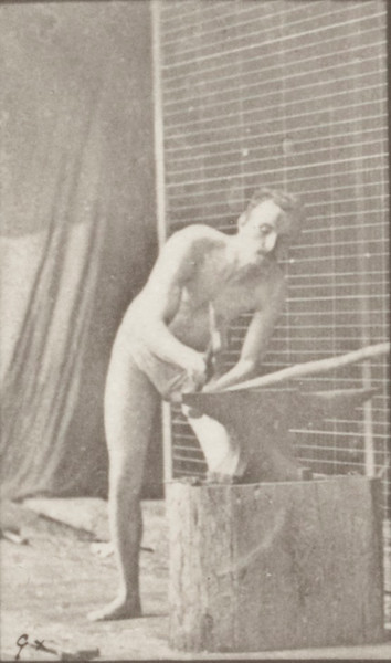 Man in pelvis cloth hammering an anvil