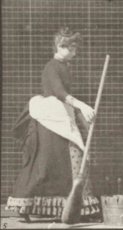 Woman in long dress and apron dropping a broom and lifting a bucket of water