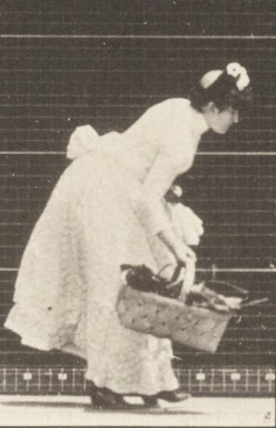 Woman lifting a basket