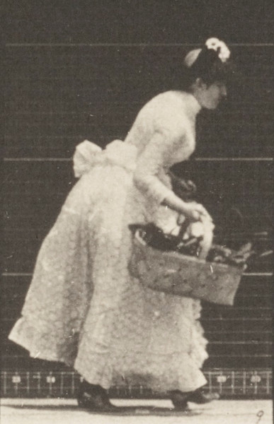 Woman lifting a basket
