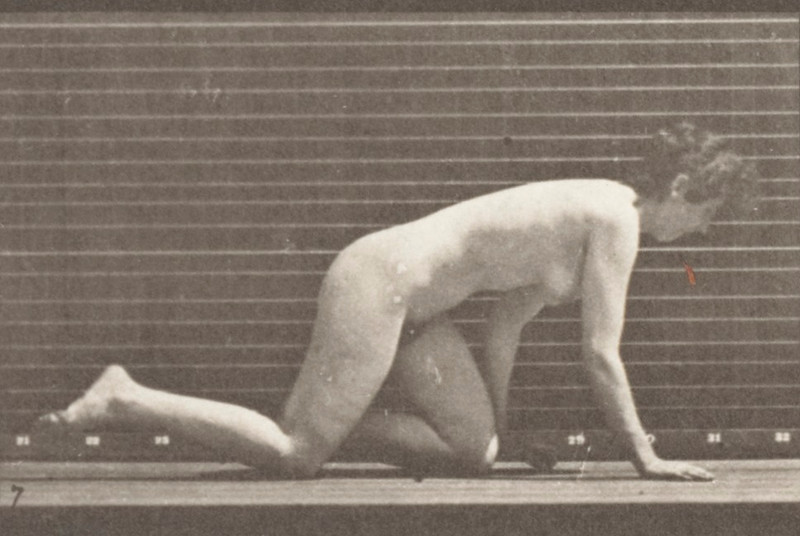 Nude woman crawling