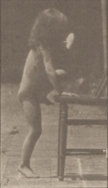 Nude child climbing