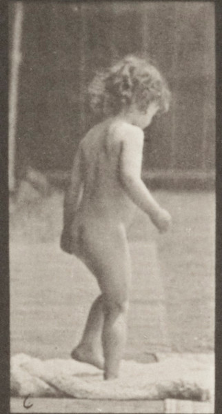 Nude child sitting down