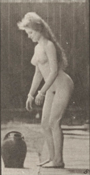 Nude woman turning and lifting a water jar from the ground