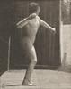 Nude man throwing baseball