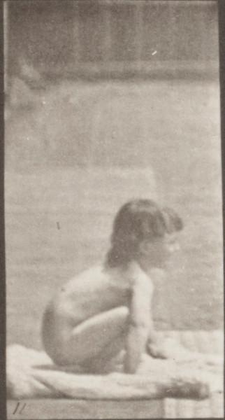 Nude child sitting down