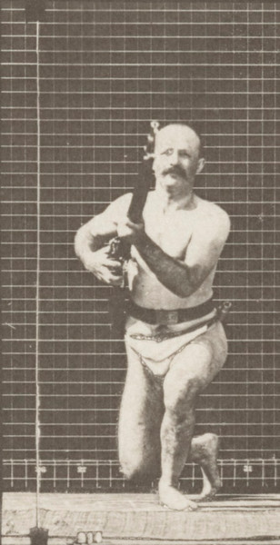 Man in pelvis cloth kneeling, firing a bayonet and rising