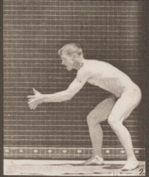 Nude man catching and throwing baseball