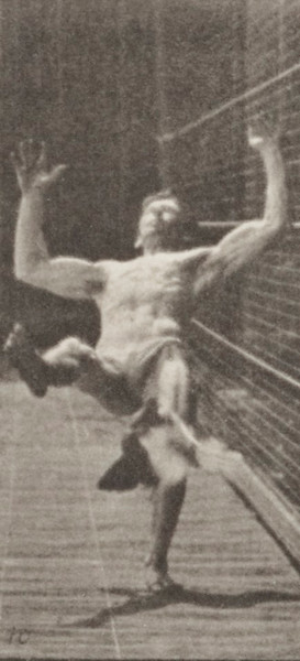 Man in pelvis cloth performing flip