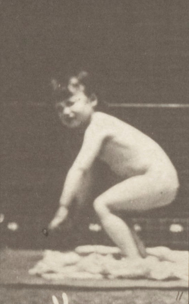 Nude child standing up