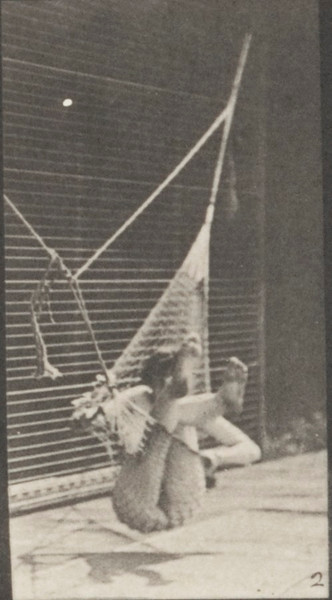 Nude woman getting out of a hammock