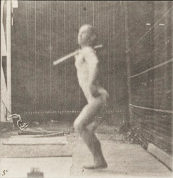 Man in pelvis cloth throwing spear