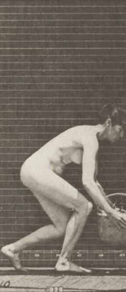 Nude woman taking basket from head
