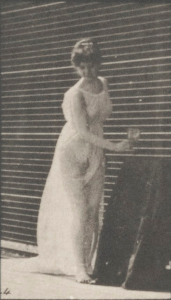 Draped woman pouring a libation on the ground and drinking from a goblet