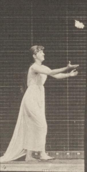 Draped woman reaching up, stooping and turning around