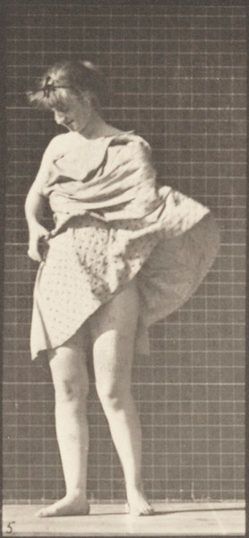 Nude woman inside toilet, putting on a dress and turning around