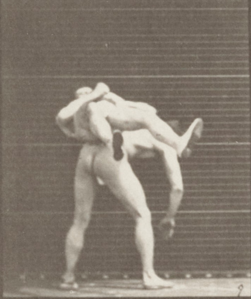 Two men in thong underwear boxing cross-buttocks
