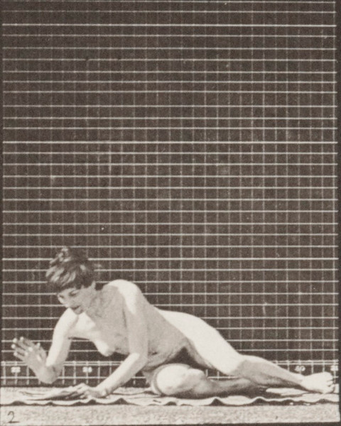 Nude woman arising from the ground with a newspaper in left hand