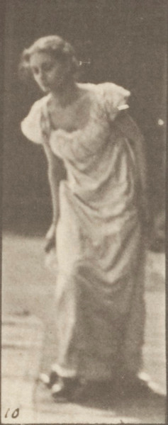 Woman in long dress stooping and lifting a handkerchief