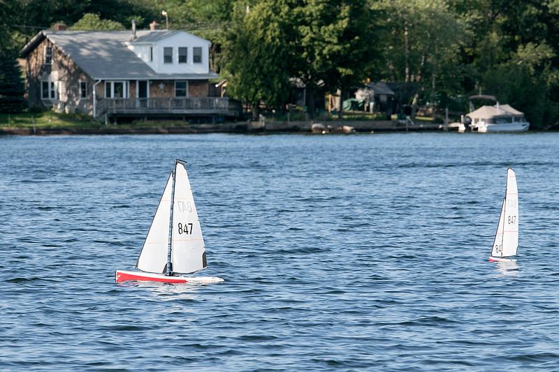 Having some fun radio controlled sailing boats on Lake Whalom in Lunenburg Thursday, August 1, 2019 was Leominster residents Russ Hume and Sam Giadone. The boats they were sailing were called Dragon sailing boats. Hume got into the hobby about 8 months ago and Giadone, hat, has been into it for about three months. SENTINEL & ENTERPRISE/JOHN LOVE