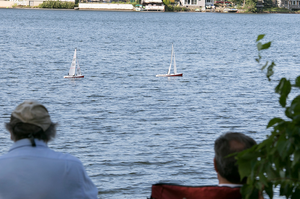 . Having some fun radio controlled sailing boats on Lake Whalom in Lunenburg Thursday, August 1, 2019 was Leominster residents Russ Hume and Sam Giadone. The boats they were sailing were called Dragon sailing boats. Hume got into the hobby about 8 months ago and Giadone, hat, has been into it for about three months. SENTINEL & ENTERPRISE/JOHN LOVE