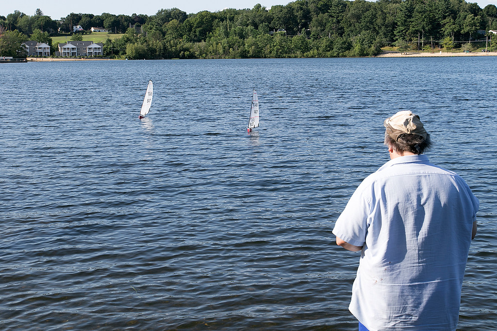 . Having some fun radio controlled sailing boats on Lake Whalom in Lunenburg Thursday, August 1, 2019 was Leominster residents Russ Hume and Sam Giadone. The boats they were sailing were called Dragon sailing boats. Hume got into the hobby about 8 months ago and Giadone, hat, has been into it for about three months. Giadone tries to get his boat unstuck during it\'s time on the water. SENTINEL & ENTERPRISE/JOHN LOVE