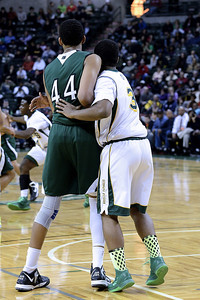 """So when I see this match up, I figured Matt Bullock is in hot water.  He is covering Karl Towns, the 7'1"""" Gatorade Player of the Year, after all.  Towns throws he weight across his his to drive Bullock off him.   Nothing happens!  Bullock flexes forward into Towns and moves him!  Right then I knew that Matt Bullock is not intimated and not going to pushed around by anyone.  As I looked at the pictures, I realized that I only had two good shots of Bullock, which is odd because he is always around the ball.  So I put them up front in the display, so nobody forgets the job he did.  And I will post a few of him from other games later in this directory."""