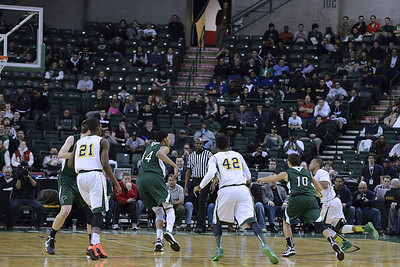 The Santil drive:  This sequence probably seems relatively normal, hardly spectacular photography, unless you name is Hakim Santil.  Then it shows you blasting by three defenders to make a layup, beating Towns to the basket.  This happened early in the game, and upon reflection, I can't imagine why such a disciplined guard like Santil is in the frontcourt, unless this was a play designed to see how Towns reacted, how far would he drop off his man.  Note that both big men for RC, Roberson (21) and Silva (42) appear to be at the top of the key.  Anyway, Santil's drives to the basket were a big weapon for RC all season long.  Pretty much nobody could stay with him.