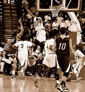 Since it was a game for the ages, I thought a little sepia added to the photo.  Here is Tyler Roberson blocking Karl Towns shot.  Roberson dominated the game in the middle, and outplayed Towns to help RC secure the win.