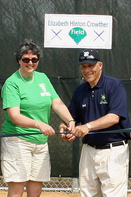 """RCC President Elizabeth H. """"Sissy"""" Crowther and Head Coach Reggie Brann cutting the ribbon at opening of new field named for RCC Softball's biggest fan."""