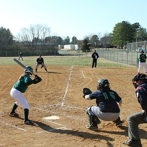 First game of 2011 versus Cecil College.  This picture was used on a piece of RCC marketing material.  Melissa Coates catching with Markie Pitts on 1st base.