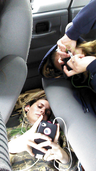 Road trip to Lynchburg..........Kate liking the floor and giving Caitlin some room on the seat.