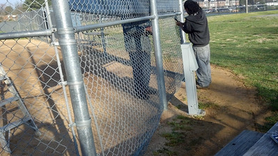 Old wire coming out for heavier gauge wire on the bottom of the backstop, March 19, 2012.