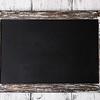 Menu board on color wooden planks background