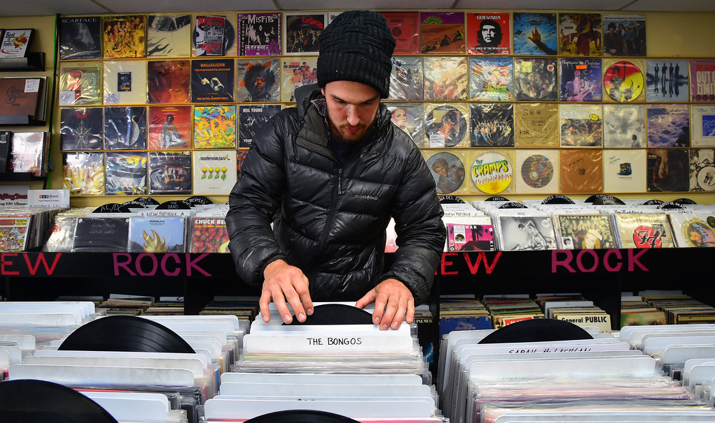 . Nick Mott searches through the vinyl collection at Bart\'s Record Shop in Boulder on Friday. Paul Aiken Staff Photographer April 6, 2018
