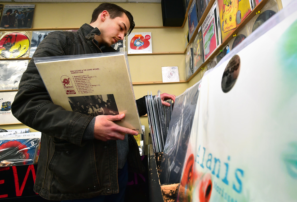. Jonathan Rogers picks out some records at Bart\'s Record Shop in Boulder on Friday. Paul Aiken Staff Photographer April 6, 2018