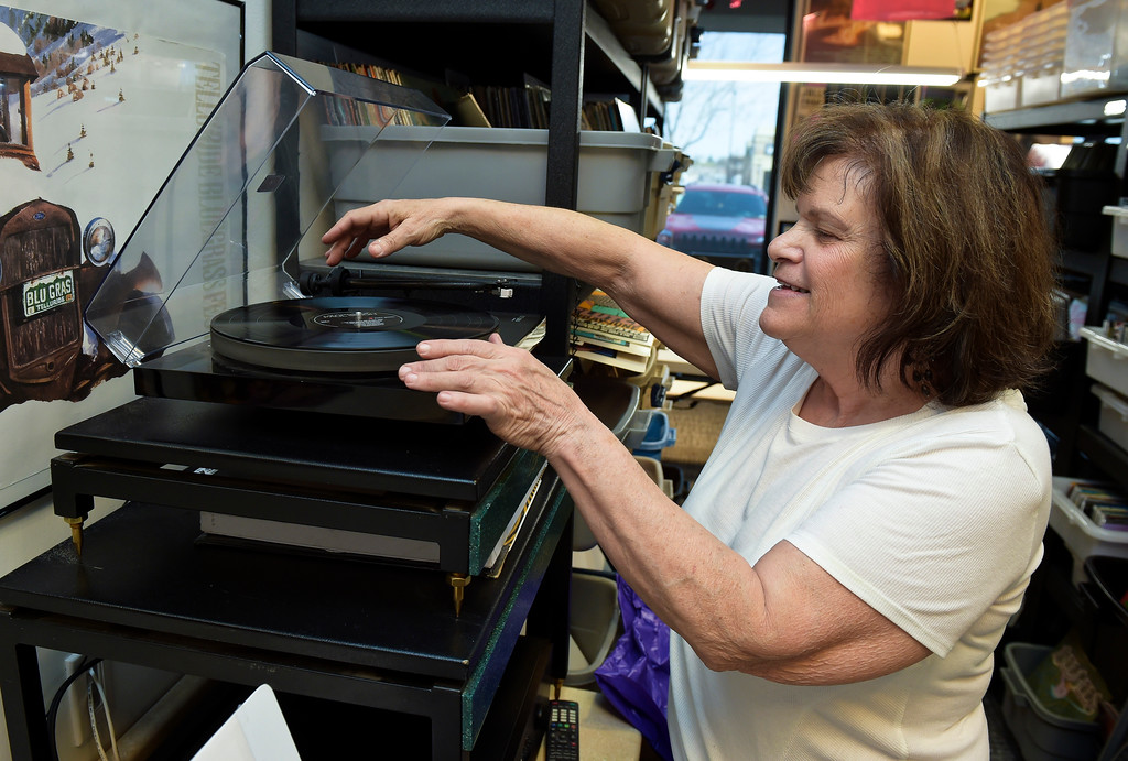 . Owner Gale Taylor takes an LP off a turntable at Recycled Records, 1067 S. Hover St., Tuesday afternoon. Lewis Geyer/Staff Photographer April 10, 2018