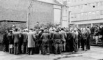 Late 1960s.  Power station workers hold an impromptu union meeting just inside Warren lane , off Beresford street