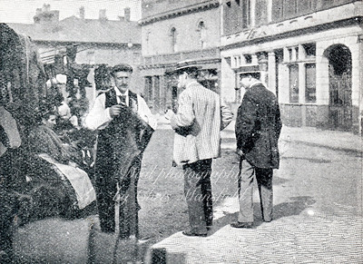 Approx' 1899. Market trader in Woolwich new road