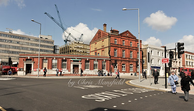 May 2010. The old Post office with the framework of the Woolwich centre in the background.