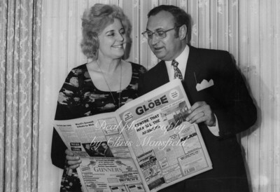 Cllr Marie Kingwell and first edition of the globe newspaper