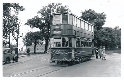 1952.  The tram is just coming out of Woolwich new road onto Grand depot road