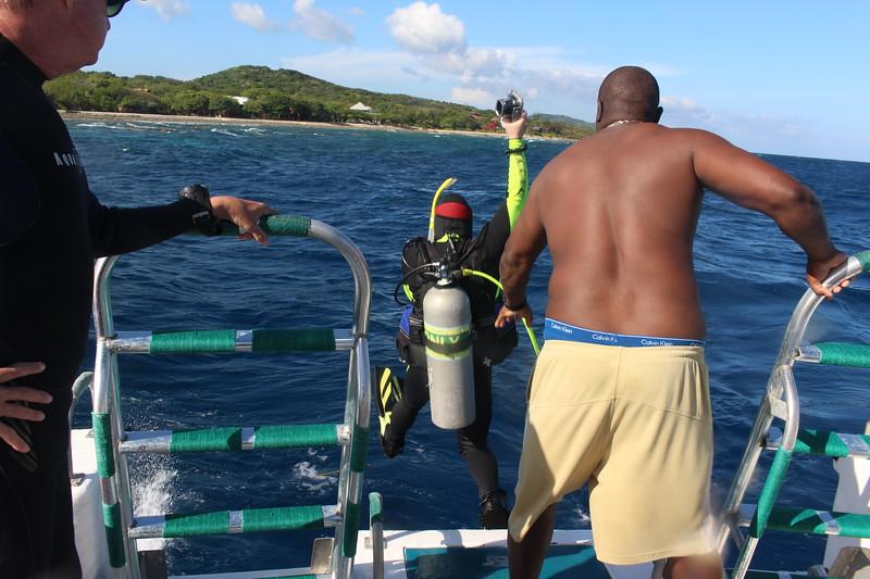 Mel helps Claude off boat