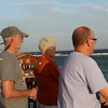Scott, and John and Deane Ware look out over the ocean