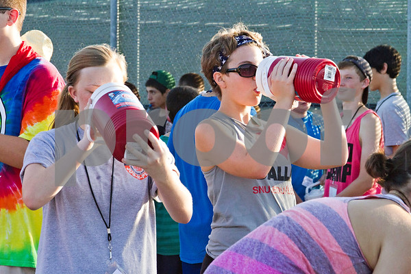 Photo by Shannon Wilson / Tyler Morning Telegraph Band students at Robert E. Lee take a much needed water break during practice on Tuesday morning.