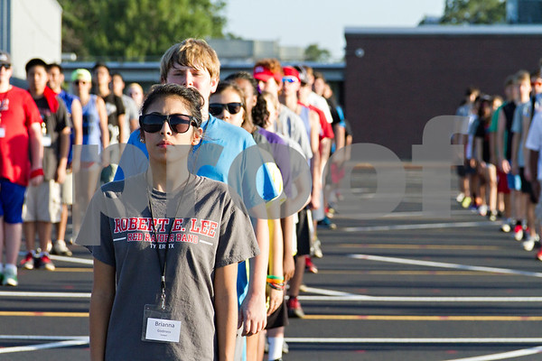 Photo by Shannon Wilson / Tyler Morning Telegraph Brianna Godiness stands at attention with many other students at band practice on Tuesday at Robert E. Lee High School.  Students are learning a new show called Ole with a spanish theme.